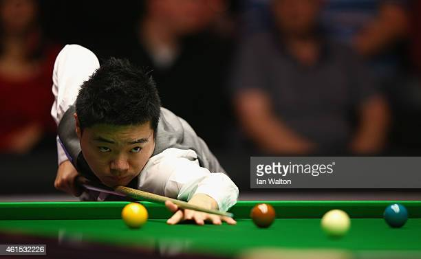 Ding Junhui of China plays a shot during his first round match against Joe Perry of England on Day Four of the 2015 Dafabet Masters at Alexandra...