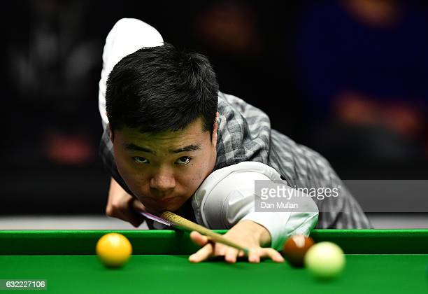 Ding Junhui of China plays a shot during his quarter final match against Joe Perry of England on day six of the Dafabet Masters at Alexandra Palace...