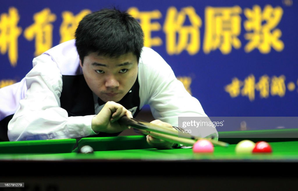 Ding Junhui of China plays a shot during the match against Michael Holt of England on day three of the 2013 World Snooker Haikou Open at Haikou Convention and Exhibition Center on February 27, 2013 in Haikou, China.