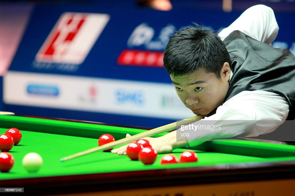 <a gi-track='captionPersonalityLinkClicked' href=/galleries/search?phrase=Ding+Junhui&family=editorial&specificpeople=214712 ng-click='$event.stopPropagation()'>Ding Junhui</a> of China plays a shot in a match against David Gilbert of England on day three of the 2013 World Snooker Shanghai Master at Shanghai Grand Stage on September 18, 2013 in Shanghai, China.