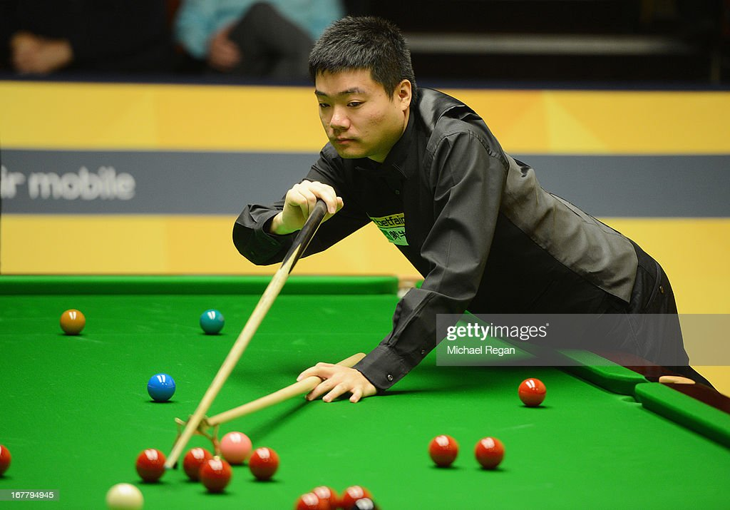 Ding Junhui of China plays a shot in his match against Barry Hawkins of England during the Betfair World Snooker Championship at the Crucible Theatre...