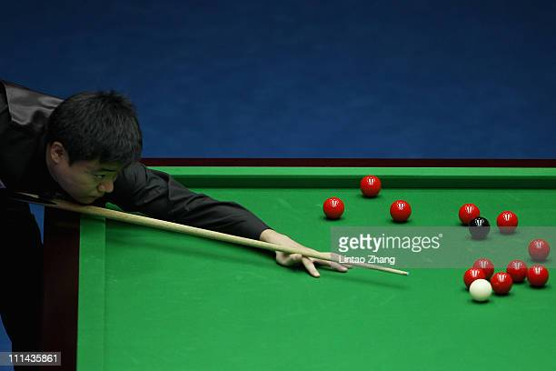Ding Junhui of China plays a shot in semifinal match against Mark Selby of England during the 2011 China Open at Beijing University Students...