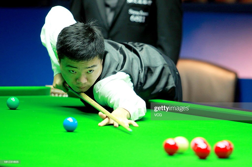 <a gi-track='captionPersonalityLinkClicked' href=/galleries/search?phrase=Ding+Junhui&family=editorial&specificpeople=214712 ng-click='$event.stopPropagation()'>Ding Junhui</a> of China plays a shot in the match against Shaun Murphy of England on day four of the 2013 World Snooker Shanghai Master at Shanghai Grand Stage on September 19, 2013 in Shanghai, China.