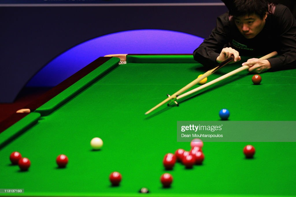 Ding Junhui of China plays a shot in the round two game against Stuart Bingham on day nine of the Betfredcom World Snooker Championship at The...