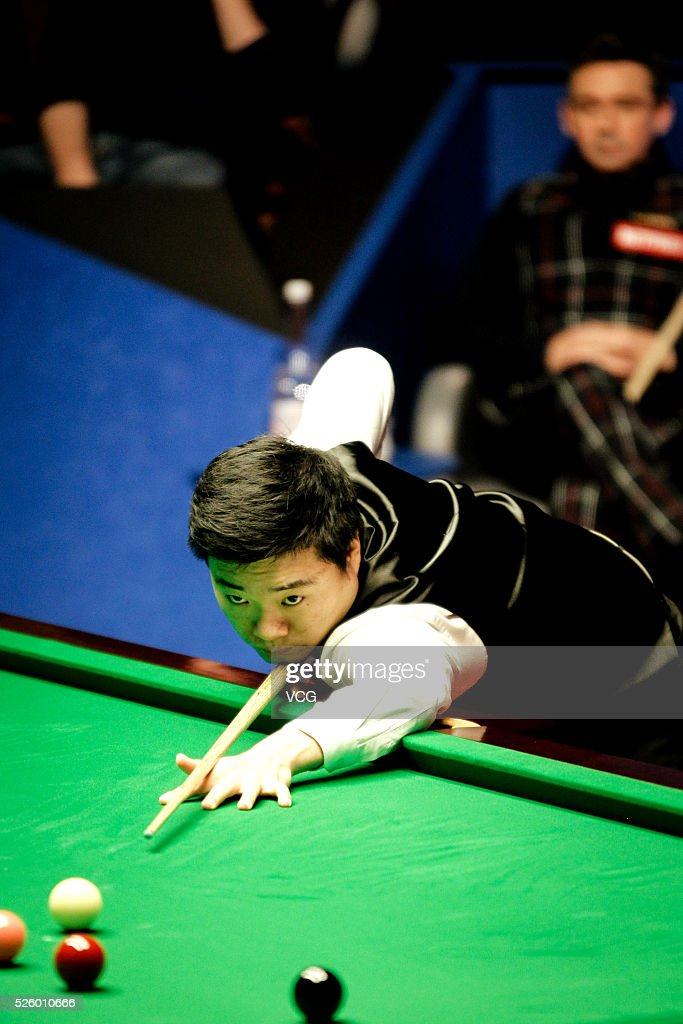Ding Junhui of China plays a shot in the second stage of his semi-final against Alan McManus of Scotland on day fourteen of Betfred World Championship 2016 at The Crucible Theatre on April 29, 2016 in Sheffield, England.