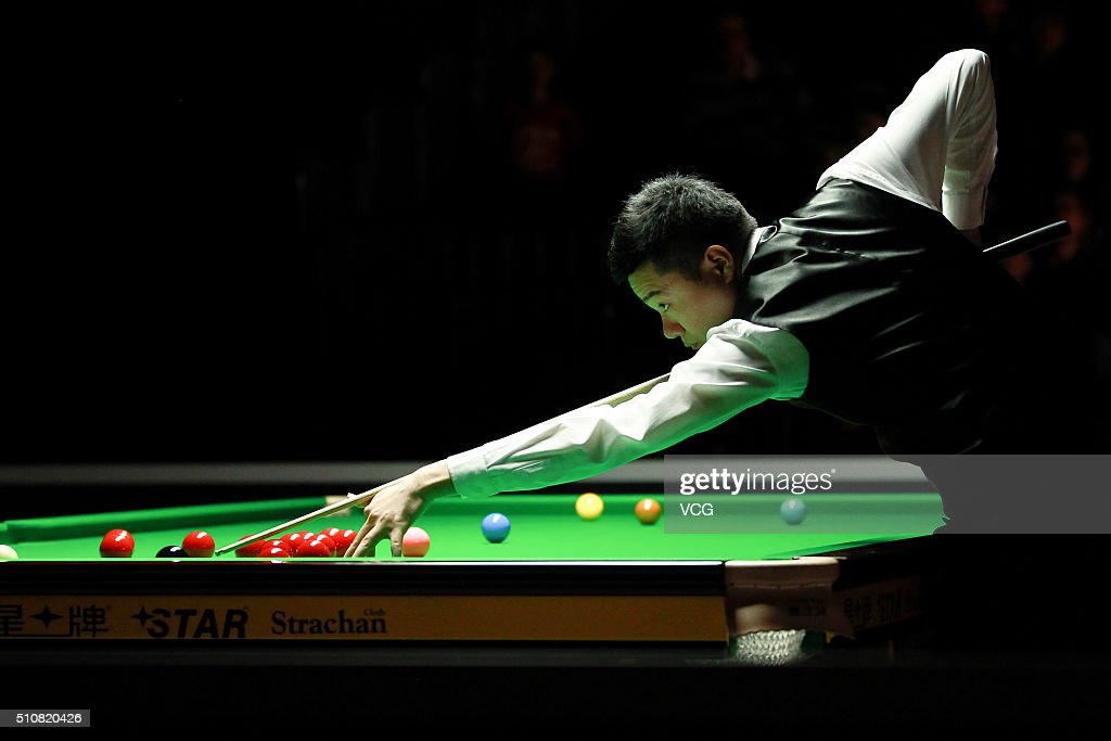 Ding Junhui of China plays a shot in the third round match against Matthew Selt of England on day three of BetVictor Welsh Open 2016 at Motorpoint...