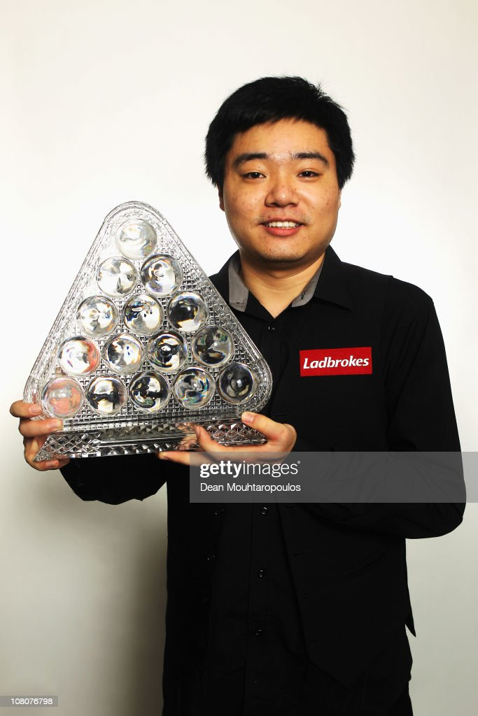 Ding Junhui of China poses with the Trophy after his victory over Marco Fu of Hong Kong in the Final of The Ladbrokesmobile Masters on Day 8 at...