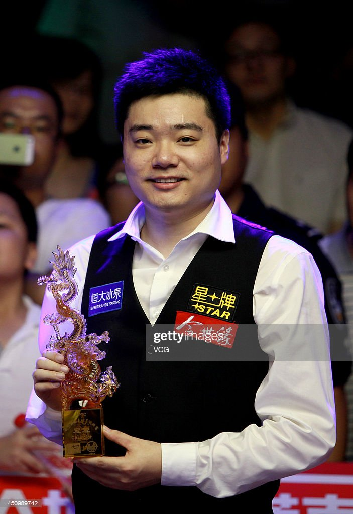 Ding Junhui of China poses with the trophy after winning the final match against Michael Holt of England during the 2014 CBSA World Snooker Tour...
