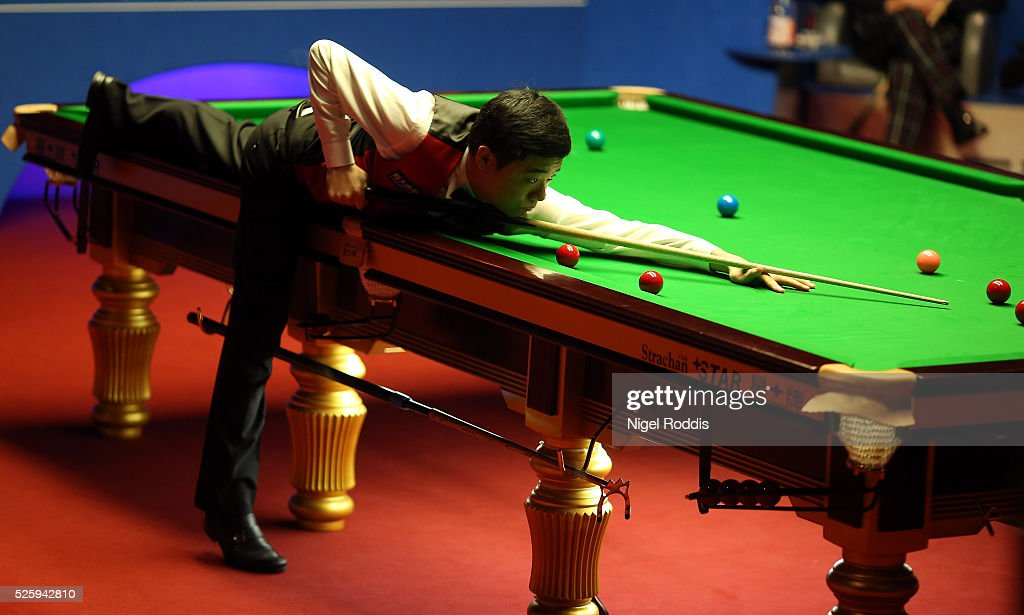 <a gi-track='captionPersonalityLinkClicked' href=/galleries/search?phrase=Ding+Junhui&family=editorial&specificpeople=214712 ng-click='$event.stopPropagation()'>Ding Junhui</a> of China reacts after the first session during his semi final match against <a gi-track='captionPersonalityLinkClicked' href=/galleries/search?phrase=Alan+McManus&family=editorial&specificpeople=228666 ng-click='$event.stopPropagation()'>Alan McManus</a> of Scotland on day fourteen of the World Championship Snooker at Crucible Theatre on April 29, 2016 in Sheffield, England.