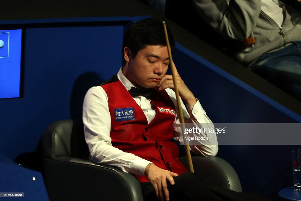 <a gi-track='captionPersonalityLinkClicked' href=/galleries/search?phrase=Ding+Junhui&family=editorial&specificpeople=214712 ng-click='$event.stopPropagation()'>Ding Junhui</a> of China reacts during his semi final match against Alan McManus of Scotland on day fourteen of the World Championship Snooker at Crucible Theatre on April 29, 2016 in Sheffield, England.