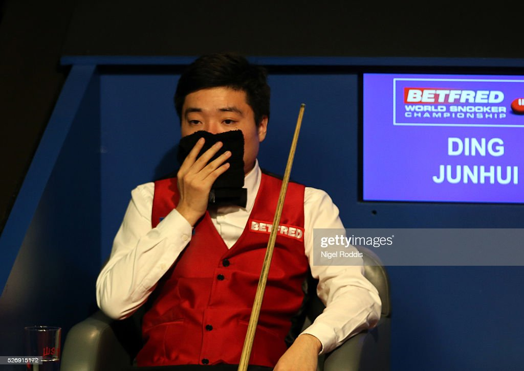 Ding Junhui of China reacts during the final against Mark Selby of England on day sixteen of the World Championship Snooker at Crucible Theatre on May 01, 2016 in Sheffield, England.