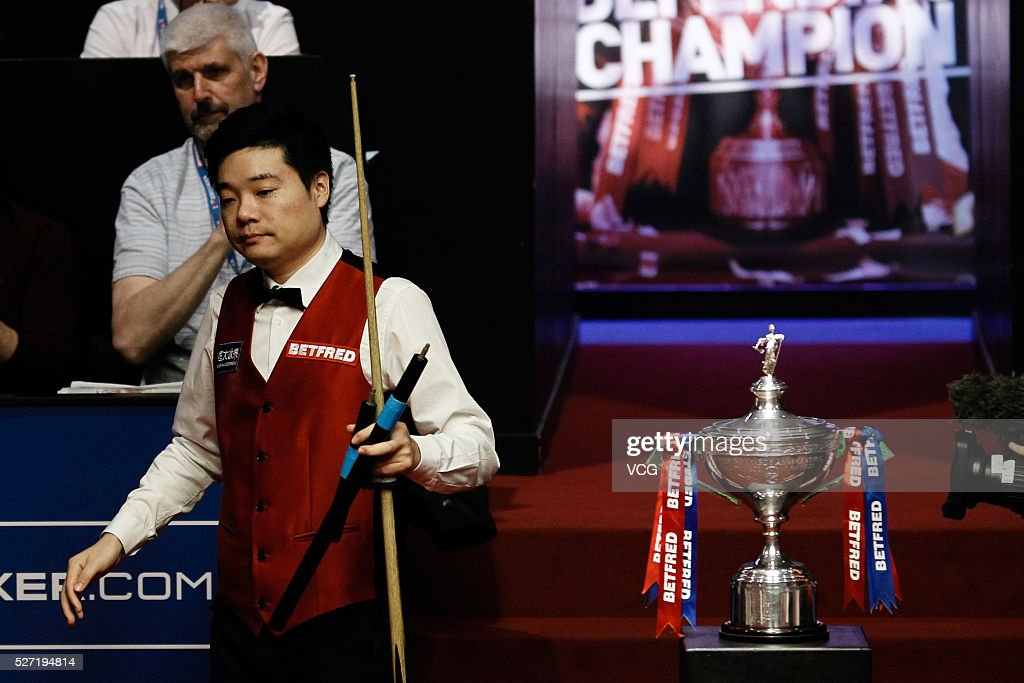 Ding Junhui of China reacts in the final match against Mark Selby of England on day seventeen of Betfred World Championship 2016 at The Crucible Theatre on May 2, 2016 in Sheffield, England.
