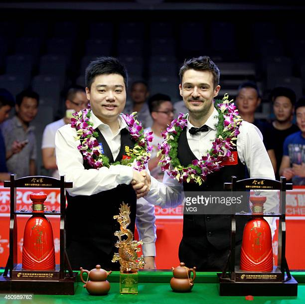 Ding Junhui of China shakes hands with Michael Holt of England after their final match during the 2014 CBSA World Snooker Tour Yixing Competition at...