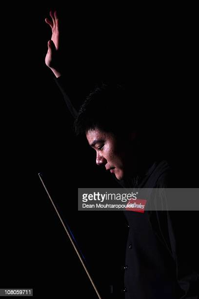Ding Junhui of China walks out to play against Jamie Cope of England in the semi final match at The Ladbrokesmobile Masters on Day 7 at Wembley Arena...