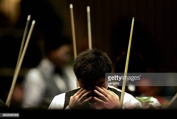 Ding Junhui of China with cue and table at a match of Snooker during the 2005 World Games held in Duisburg Germany