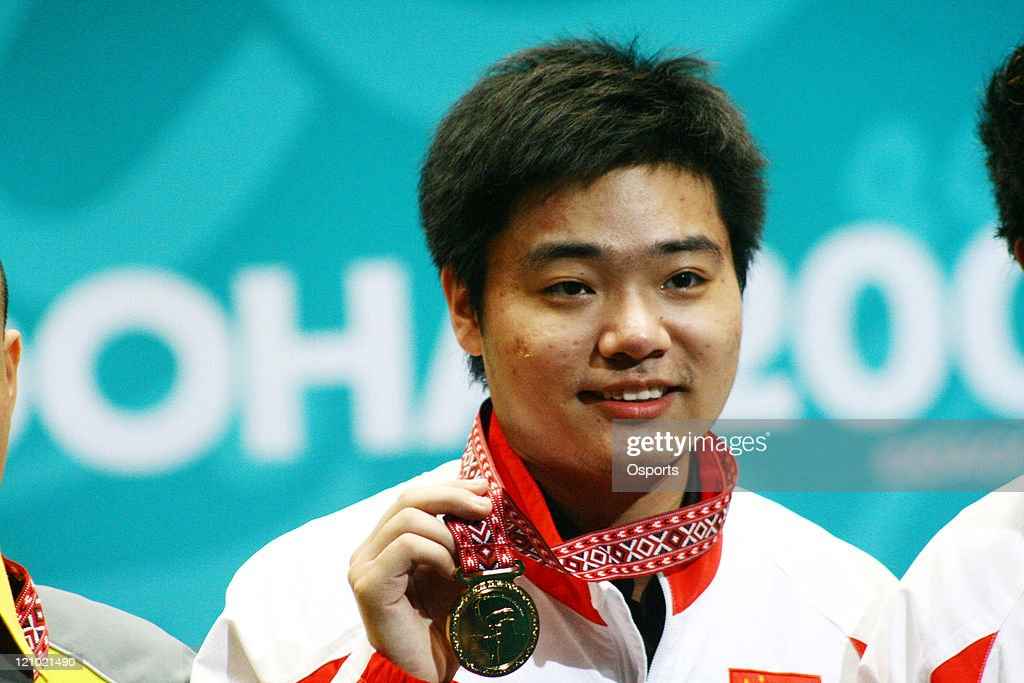 Ding Junhui of China with the Gold Medal after the Men's Snooker Team match between China and Macau at the 15th Asian Games in Doha Qatar on December...
