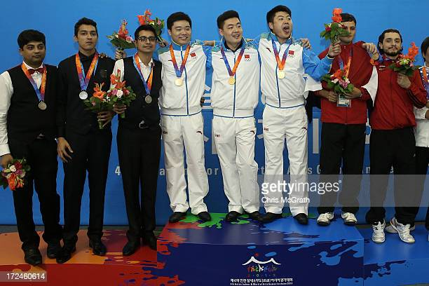 Ding Junhui Tian Pengfei and Liang Wenbo of China celebrate their gold medal during the Billiards Men's Team Gold Medal Match between China and...