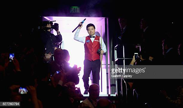 Ding Junhui walks into the arena ahead of the final session of the World Snooker Championship final at the Crucible Theatre on May 02 2016 in...