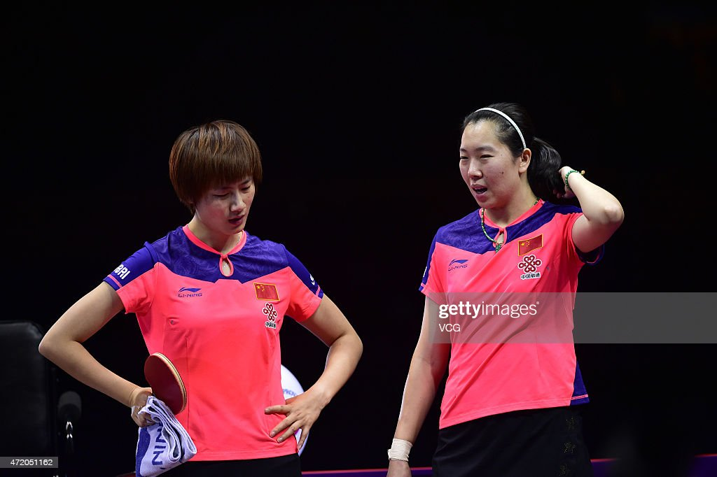 <a gi-track='captionPersonalityLinkClicked' href=/galleries/search?phrase=Ding+Ning&family=editorial&specificpeople=2161349 ng-click='$event.stopPropagation()'>Ding Ning</a> (L) and Li Xiaoxia of China react against Liu Shiwen and Zhu Yuling of China during women's doubles final match on day eight of the 2015 World Table Tennis Championships at the Suzhou International Expo Center on May 3, 2015 in Suzhou, China.