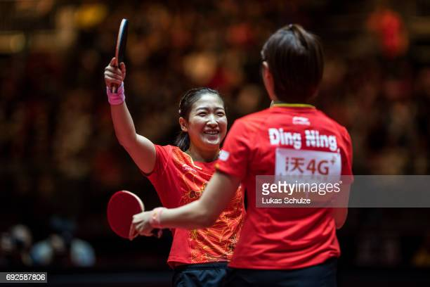 Ding Ning and Liu Shiwen of China celebrate after winning the Women's Doubles Final match during the Table Tennis World Championship at Messe...
