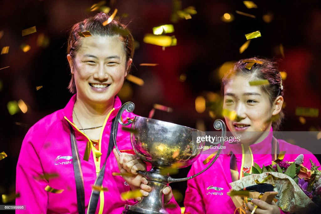 Ding Ning (L) and Liu Shiwen of China celebrate with the trophy after winning the Women's Doubles Final match during the Table Tennis World Championship at Messe Duesseldorf on June 5, 2017 in Dusseldorf, Germany.