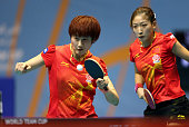 Ding Ning and Liu Shiwen of China in action against Mengyu Yu and Tianwei Feng of Singapore during the semi finals of the 2015 IFFT World Team Cup at...