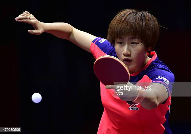 Ding Ning of China competes against Li Jie of the Netherlands and Li Qian of Poland with Li Xiaoxia during women's singles semifinal match on day...