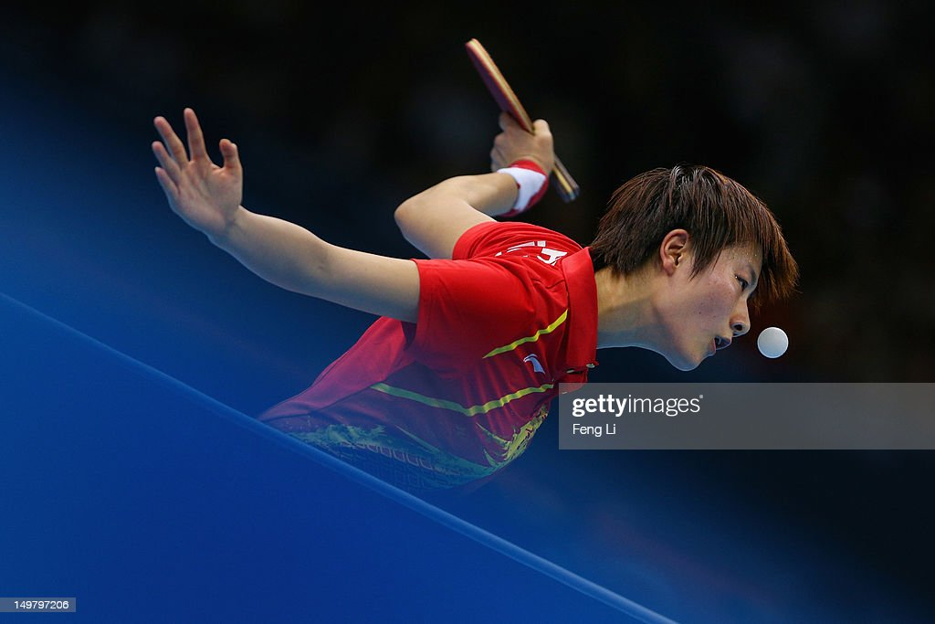 <a gi-track='captionPersonalityLinkClicked' href=/galleries/search?phrase=Ding+Ning&family=editorial&specificpeople=2161349 ng-click='$event.stopPropagation()'>Ding Ning</a> of China competes during Women's Team Table Tennis first round match against team of Netherlands on Day 8 of the London 2012 Olympic Games at ExCeL on August 4, 2012 in London, England.