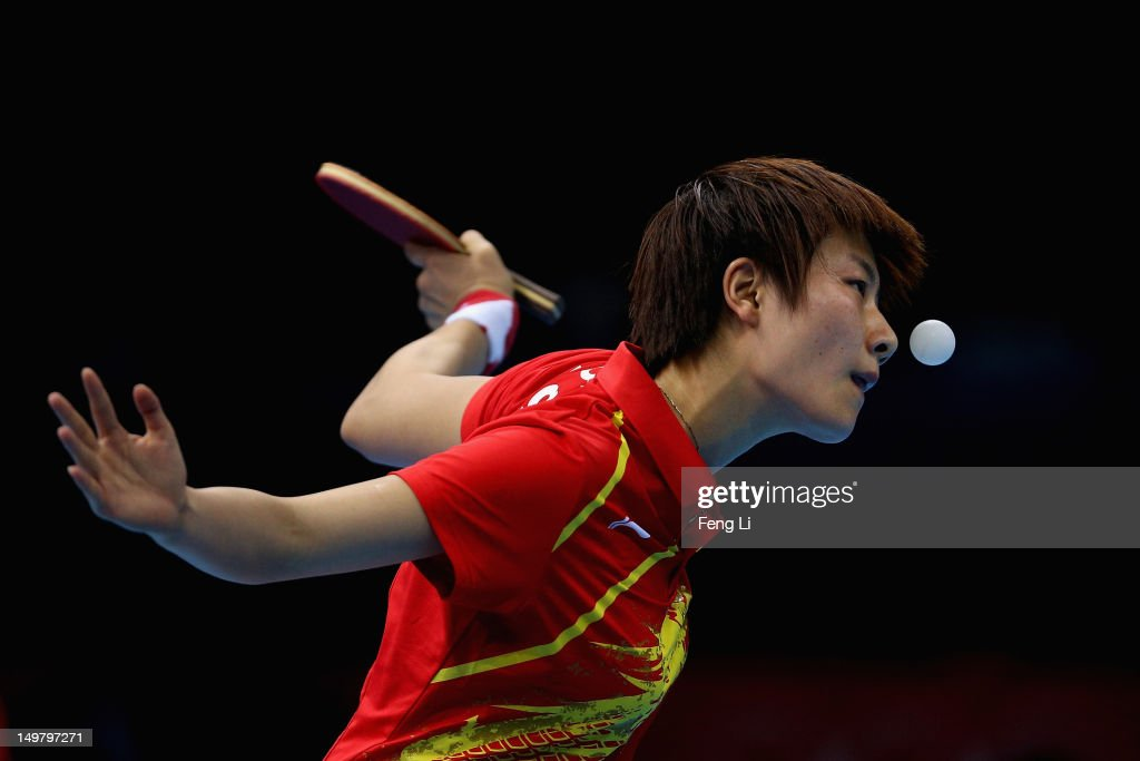 <a gi-track='captionPersonalityLinkClicked' href=/galleries/search?phrase=Ding+Ning&family=editorial&specificpeople=2161349 ng-click='$event.stopPropagation()'>Ding Ning</a> of China competes during Women's Team Table Tennis quarter-final match against team of Netherlands on Day 8 of the London 2012 Olympic Games at ExCeL on August 4, 2012 in London, England.