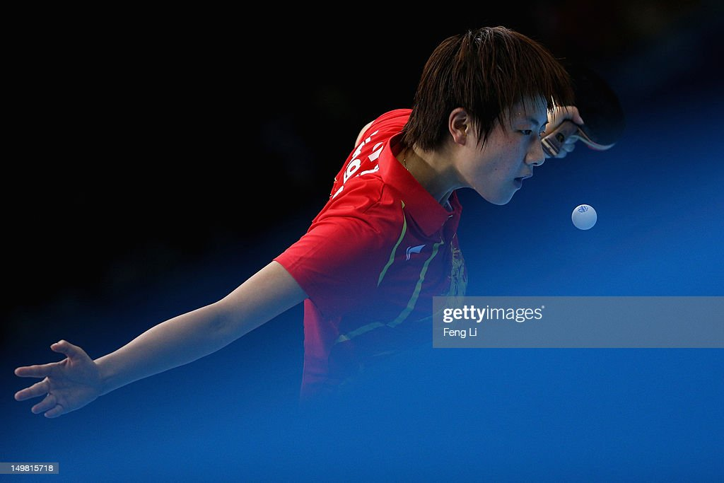 Ding Ning of China competes during Women's Team Table Tennis quarter-final match against team of Netherlands on Day 8 of the London 2012 Olympic Games at ExCeL on August 4, 2012 in London, England.