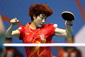 Ding Ning of China in action against Mengyu Yu and Tianwei Feng of Singapore during the semi finals of the 2015 IFFT World Team Cup at the Al Nasr...