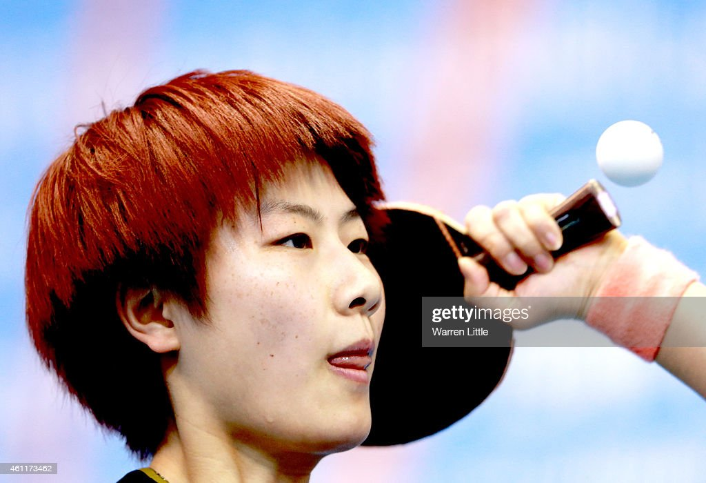 Ding Ning of China in action against Michelle Beaumont of Australia during the Women's Group 1 match on day one of the ITTF World Team Cup at the Al Nasr Sports Club on January 8, 2015 in Dubai, United Arab Emirates.