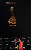 Ding Ning of China is presented with the Women's Table Tennis Star Award during the ITTF Star Awards at the Armani Hotel at Burj Khalifa on January 7...