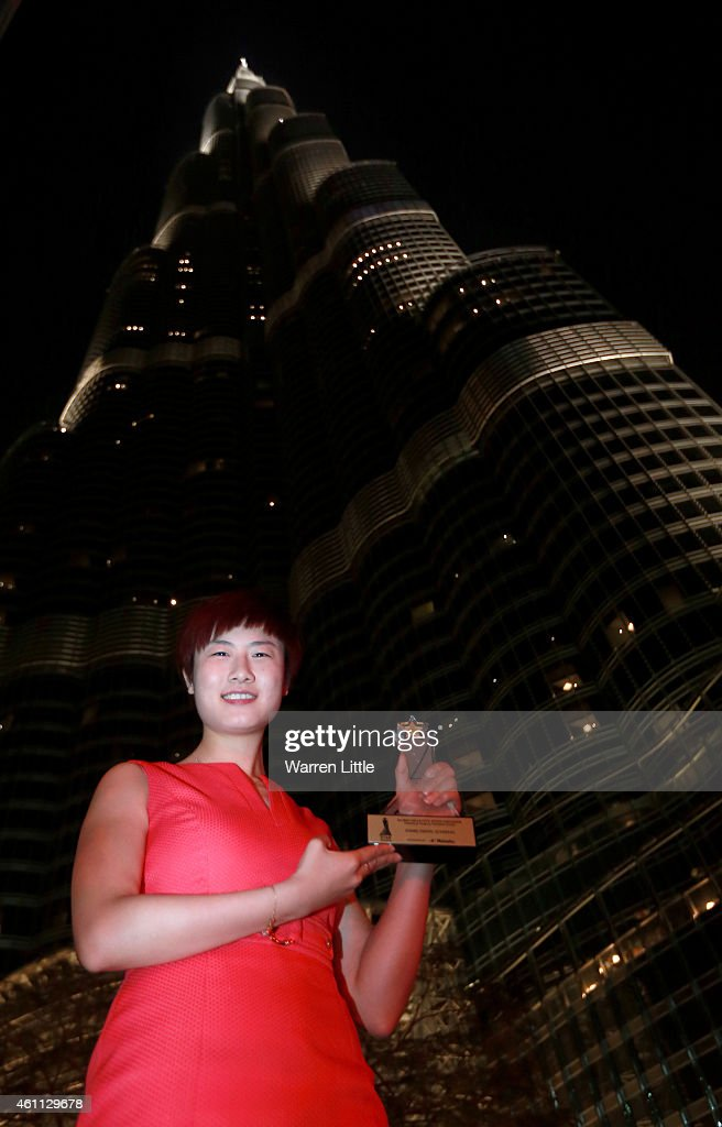 <a gi-track='captionPersonalityLinkClicked' href=/galleries/search?phrase=Ding+Ning&family=editorial&specificpeople=2161349 ng-click='$event.stopPropagation()'>Ding Ning</a> of China poses with the Women's Table Tennis Star Award during the ITTF Star Awards at the Armani Hotel at Burj Khalifa on January 7, 2015 in Dubai, United Arab Emirates.