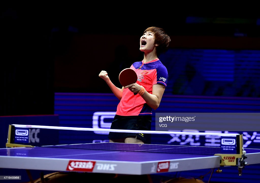Ding Ning of China reacts after winning the match against Liu Shiwen of China during women's singles final match on day seven of the 2015 World Table...