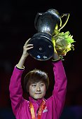 Ding Ning of Chinaposes with her trophy after winning the women's singles final match against Liu Shiwen of China at the 2015 World Table Tennis...