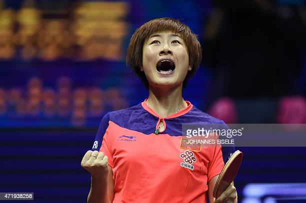 Ding Ning of Chinareacts after defeating Liu Shiwen of China in her women's singles final match at the 2015 World Table Tennis Championships at the...