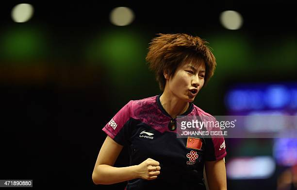 Ding Ning of Chinareacts during her women's singles semifinal match against Mu Zi of China at the 2015 World Table Tennis Championships at the...