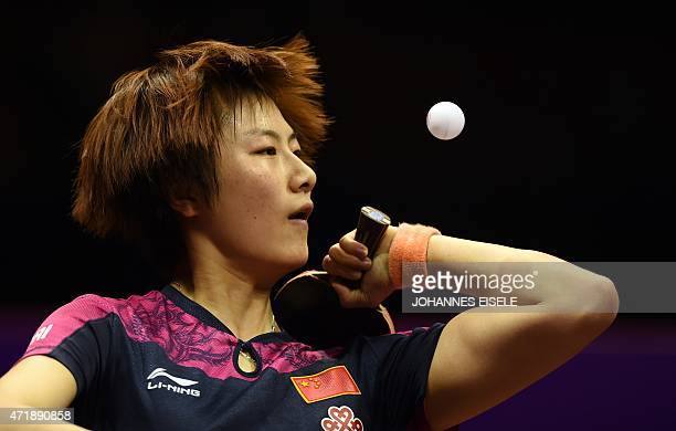 Ding Ning of Chinaserve during her women's singles semifinal match against Mu Zi of China at the 2015 World Table Tennis Championships at the Suzhou...