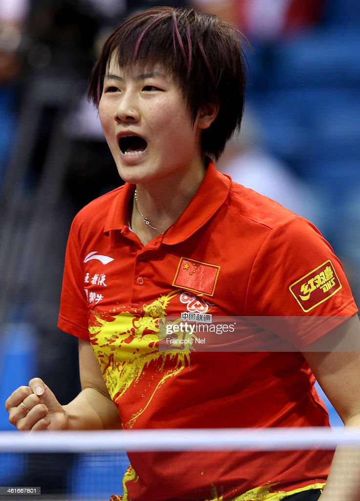 <a gi-track='captionPersonalityLinkClicked' href=/galleries/search?phrase=Ding+Ning+-+Table+Tennis+Player&family=editorial&specificpeople=2161349 ng-click='$event.stopPropagation()'>Ding Ning</a> reacts in the quater-finals of the Women's singlesduring the GAC Group 2013 ITTF World Tour Grand Finals at the Al Nasr Sports Club on January 10, 2014 in Dubai, United Arab Emirates.