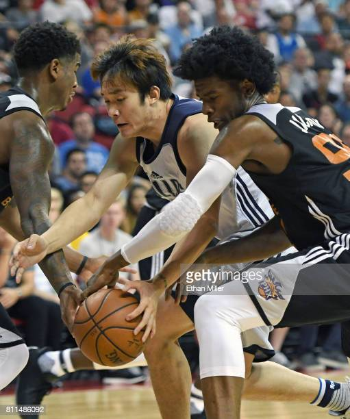 Ding Yanyuhang of the Dallas Mavericks and Josh Jackson of the Phoenix Suns go after a loose ball during the 2017 Summer League at the Thomas Mack...