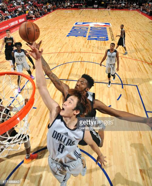 Ding Yanyuhang of the Dallas Mavericks blocks the shot against Derrick Jones Jr #10 of the Phoenix Suns during the 2017 Summer League on July 9 2017...