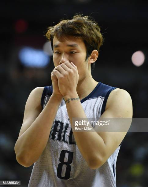Ding Yanyuhang of the Dallas Mavericks blows on his hands during a 2017 Summer League game against the Boston Celtics at the Thomas Mack Center on...
