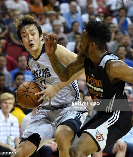 Ding Yanyuhang of the Dallas Mavericks drives against Derrick Jones Jr #10 of the Phoenix Suns during the 2017 Summer League at the Thomas Mack...