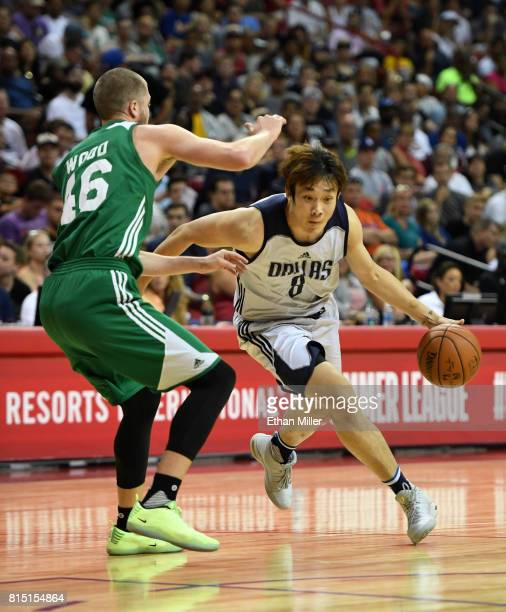 Ding Yanyuhang of the Dallas Mavericks drives against Scott Wood of the Boston Celtics during the 2017 Summer League at the Thomas Mack Center on...