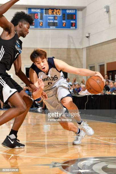 Ding Yanyuhang of the Dallas Mavericks drives to the basket against the Orlando Magic on July 3 2017 during the 2017 Summer League at Amway Center in...
