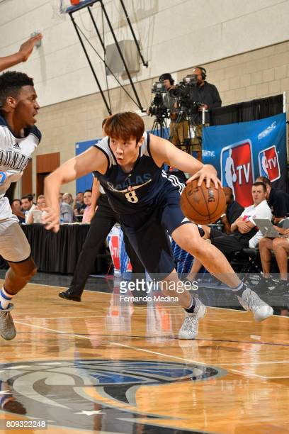 Ding Yanyuhang of the Dallas Mavericks drives to the basket against the Oklahoma City Thunder during the Mountain Dew Orlando Pro Summer League on...