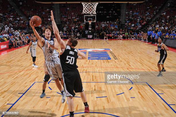 Ding Yanyuhang of the Dallas Mavericks drives to the basket during the 2017 NBA Las Vegas Summer League game against the Sacramento Kings on July 13...