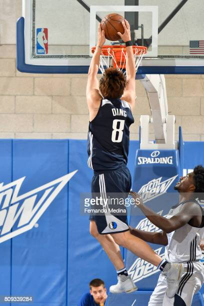 Ding Yanyuhang of the Dallas Mavericks dunks the ballagainst the Oklahoma City Thunder during the Mountain Dew Orlando Pro Summer League on July 5...