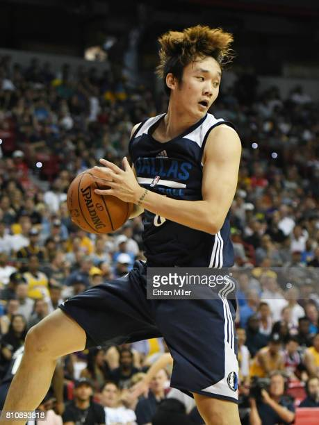Ding Yanyuhang of the Dallas Mavericks grabs a rebound against the Chicago Bulls during the 2017 Summer League at the Thomas Mack Center on July 8...